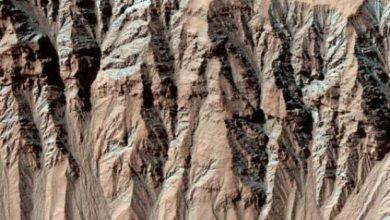 Photo de Rien à voir avec la Terre, les ravines sur Mars ne seraient pas dues à l'eau